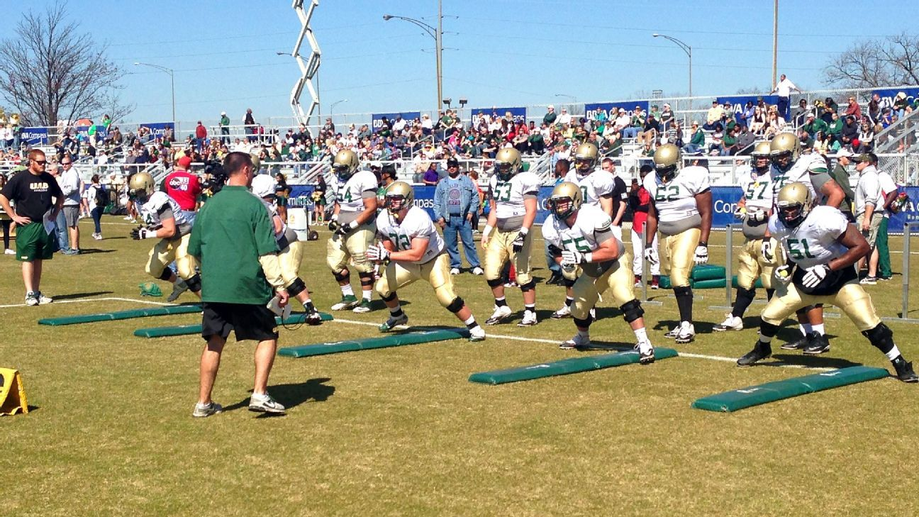 UAB's offensive line works out at its open practice in March 2016. I took this photo while on assignment for a story about the revival of the program, less than two years after the school's leadership shut it down. (ESPN)