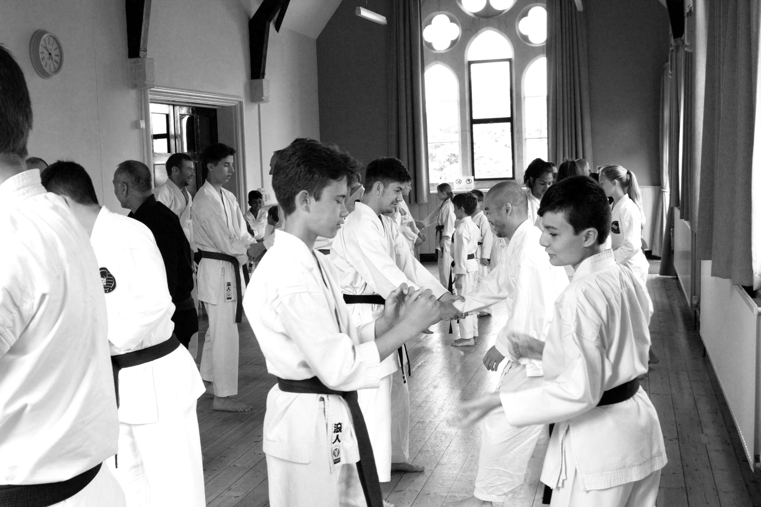 Karate is a long term commitment and many of our young students have continued training with us. We encourage all students to reach black belt. Many cannot last the duration but a few committed and spirited students get there. Ozan; on the right, has reached 2nd Dan.