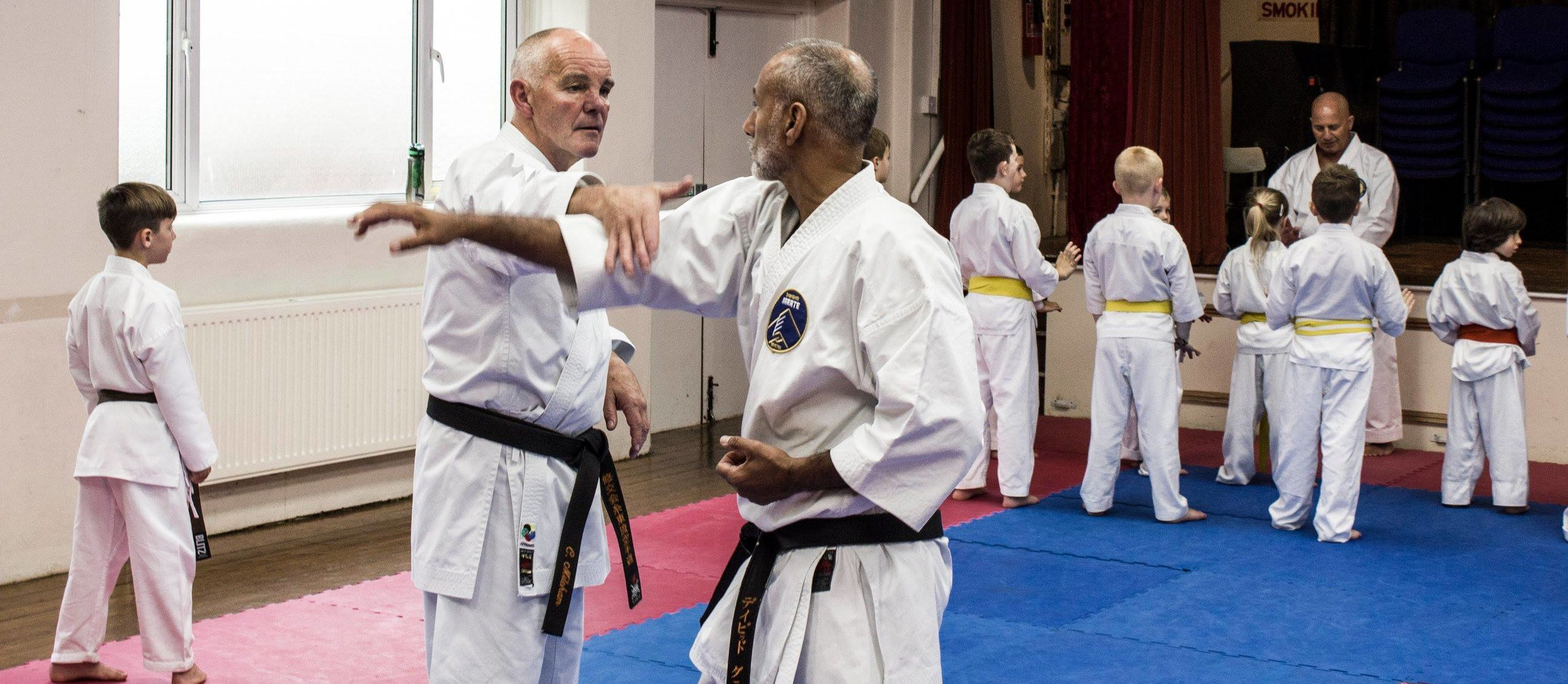 Sensei Mileham 7th Dan demonstrates a self defence technique on myself at or St Saviours dojo