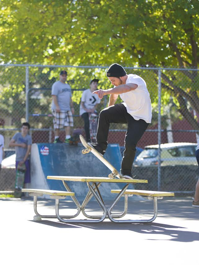 This dude fucked the picnic table up all day, frontside bluntslide