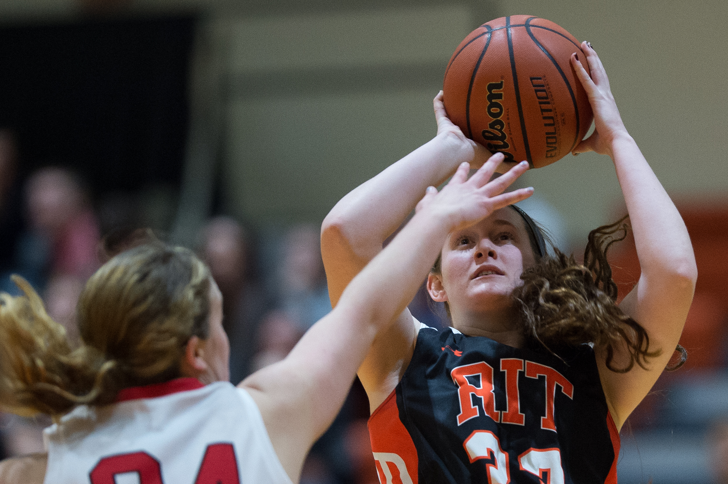 RPI Engineers Ashley Clough, 24, attempts to block the shot of RIT Tigers Amanda Olsen, 33, in the Clark Gym on the Rochester Insitute of Technology campus in Henrietta, N.Y. on Jan. 29, 2016. The Tigers went on to defeat the Engineers 68-64.