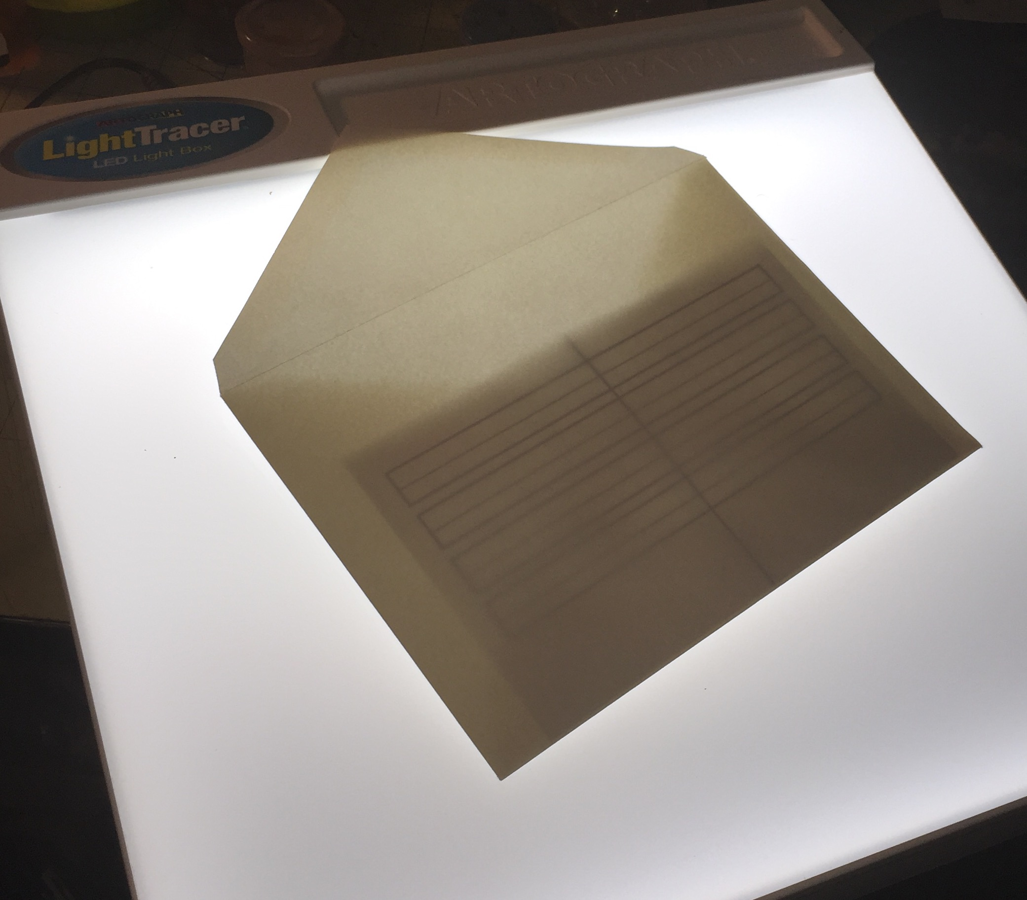 "Non-opaque envelopes or papers are pretty much ""solved"" with a lightbox. I use a Light Tracer... They are starting to make them flat, but I prefer the slanted surface."