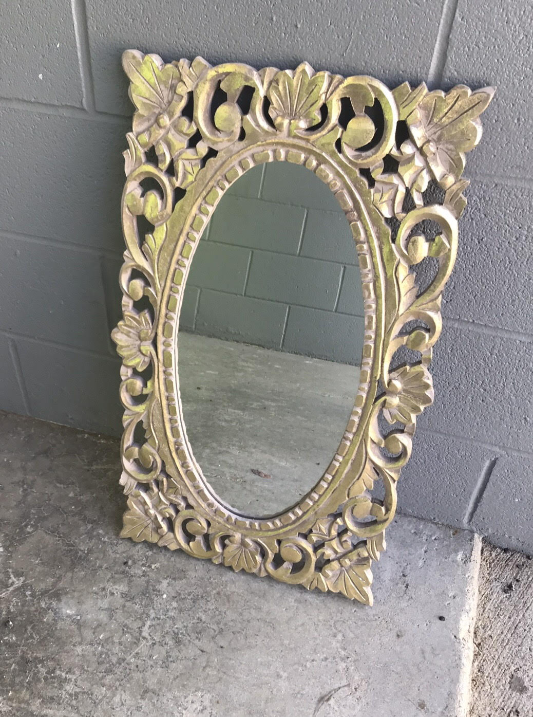 """Gold ornate mirror that's great for the bar or your memorial. $25 