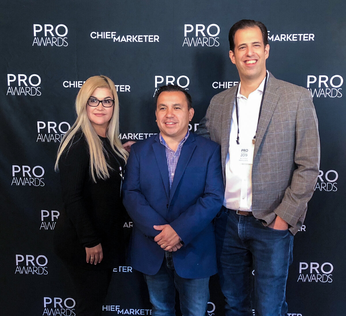 Liliana Miranda and David Rothkopf of Marketing Werks with Ruben Robledo of Univision