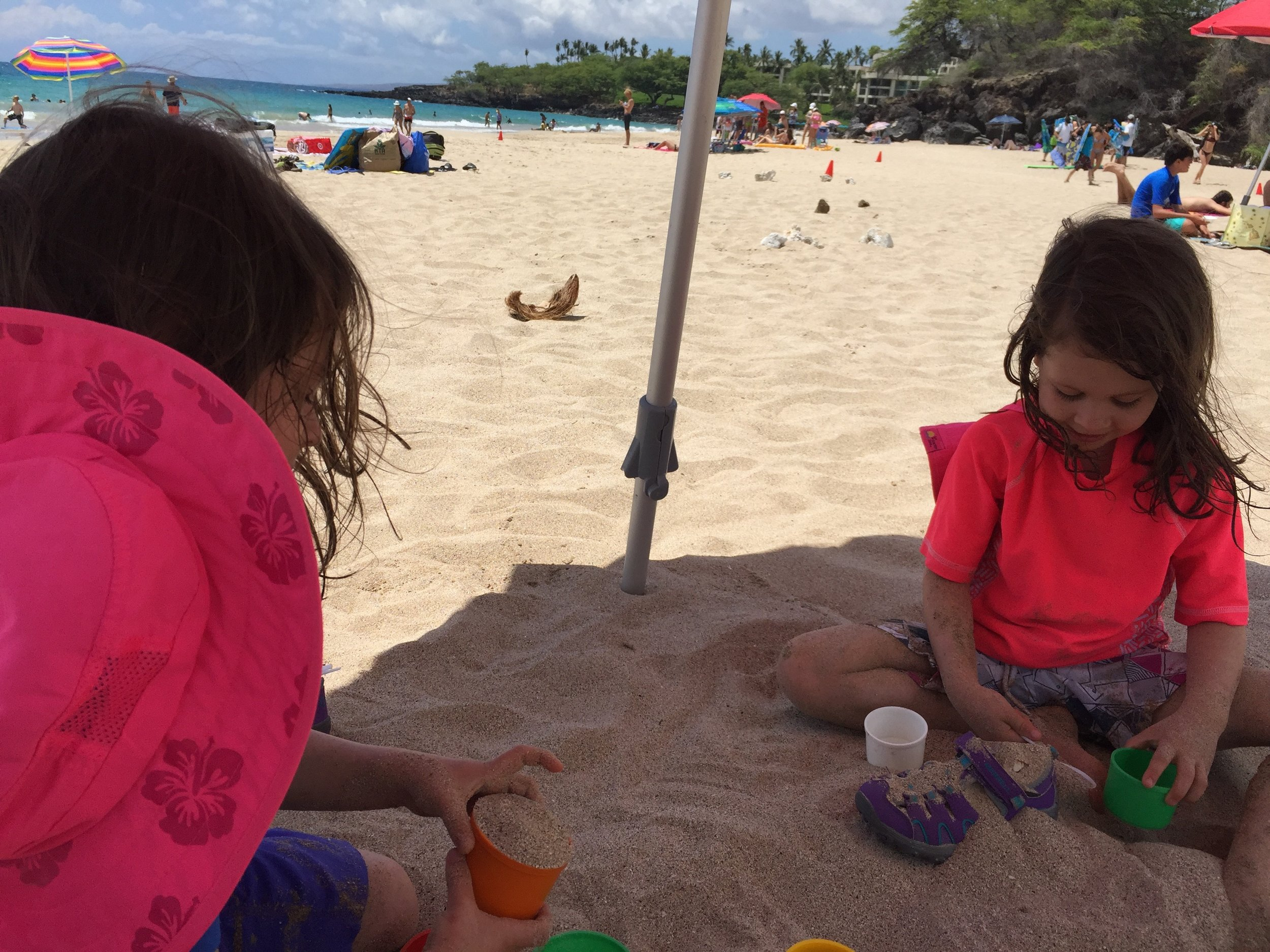 At Hapuna Beach State Park playing with spoons and stacking cups.