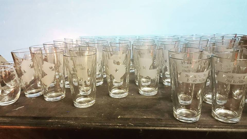 Custom, hand etched glasses being prepared for shipment.
