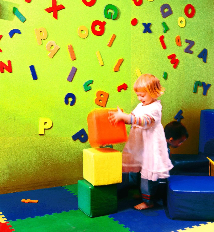 girl at magnet wall copy.jpg