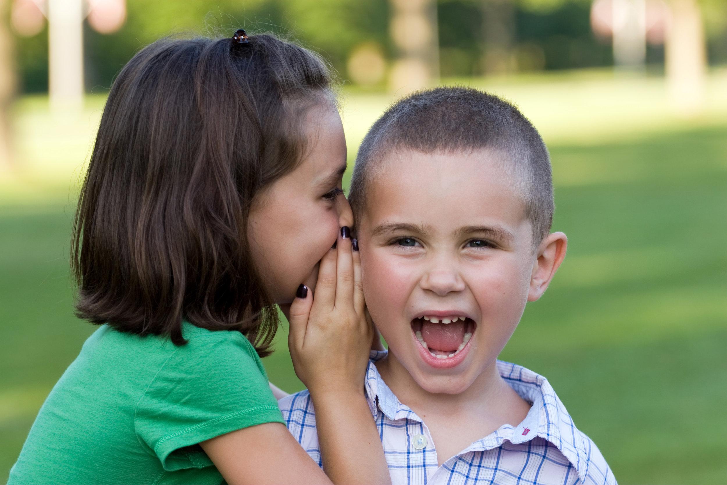 a-young-girl-telling-her-brother-a-secret_rKFsAd0Bi.jpg