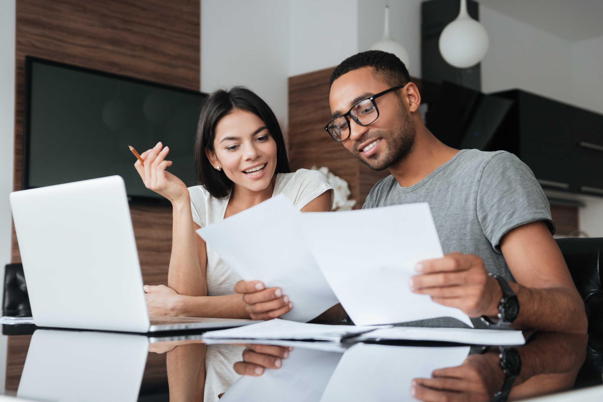 graphicstock-photo-of-cheerful-loving-young-couple-using-laptop-and-analyzing-their-finances-with-documents-look-at-papers_r8sI1YQ_hx.jpg