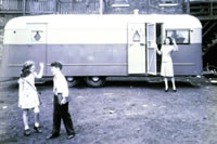 Old Trailer With Kids and Parent