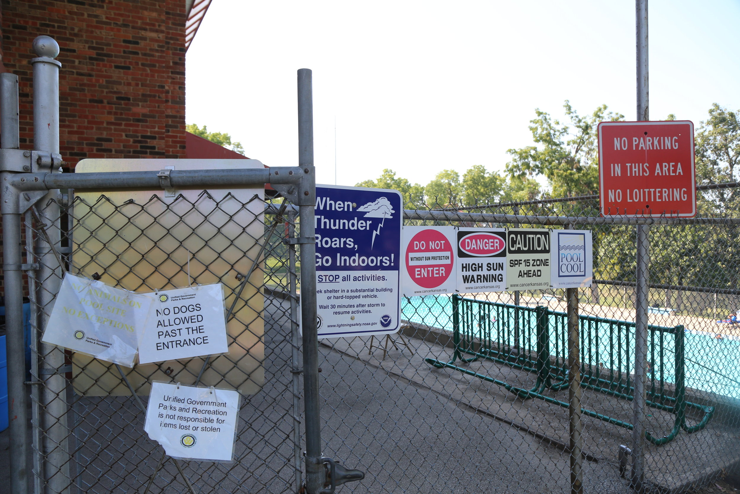 Parkwood Pool signs convey a tone.