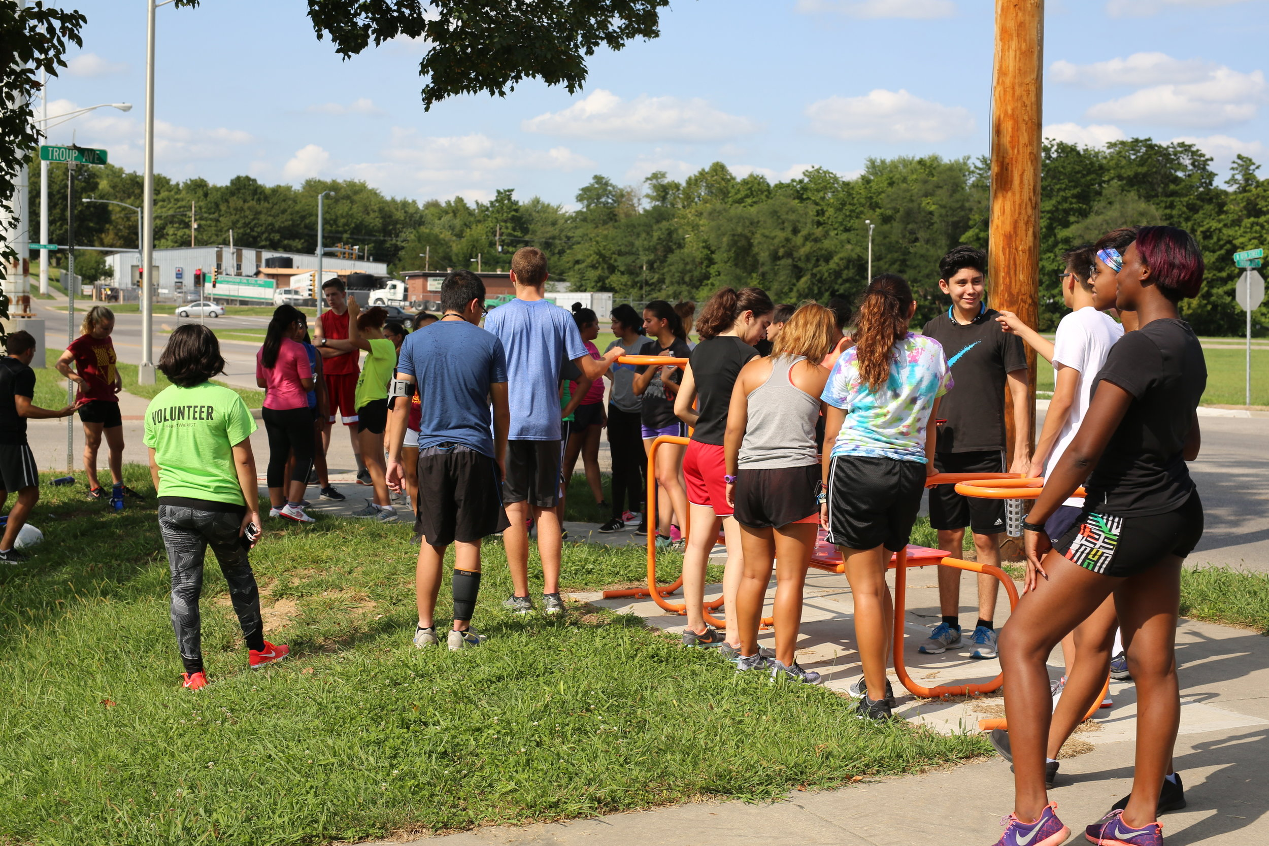 Sumner Academy cross-country runners meet before a run at one of the  Jersey Creek Fitness Trail Stations .