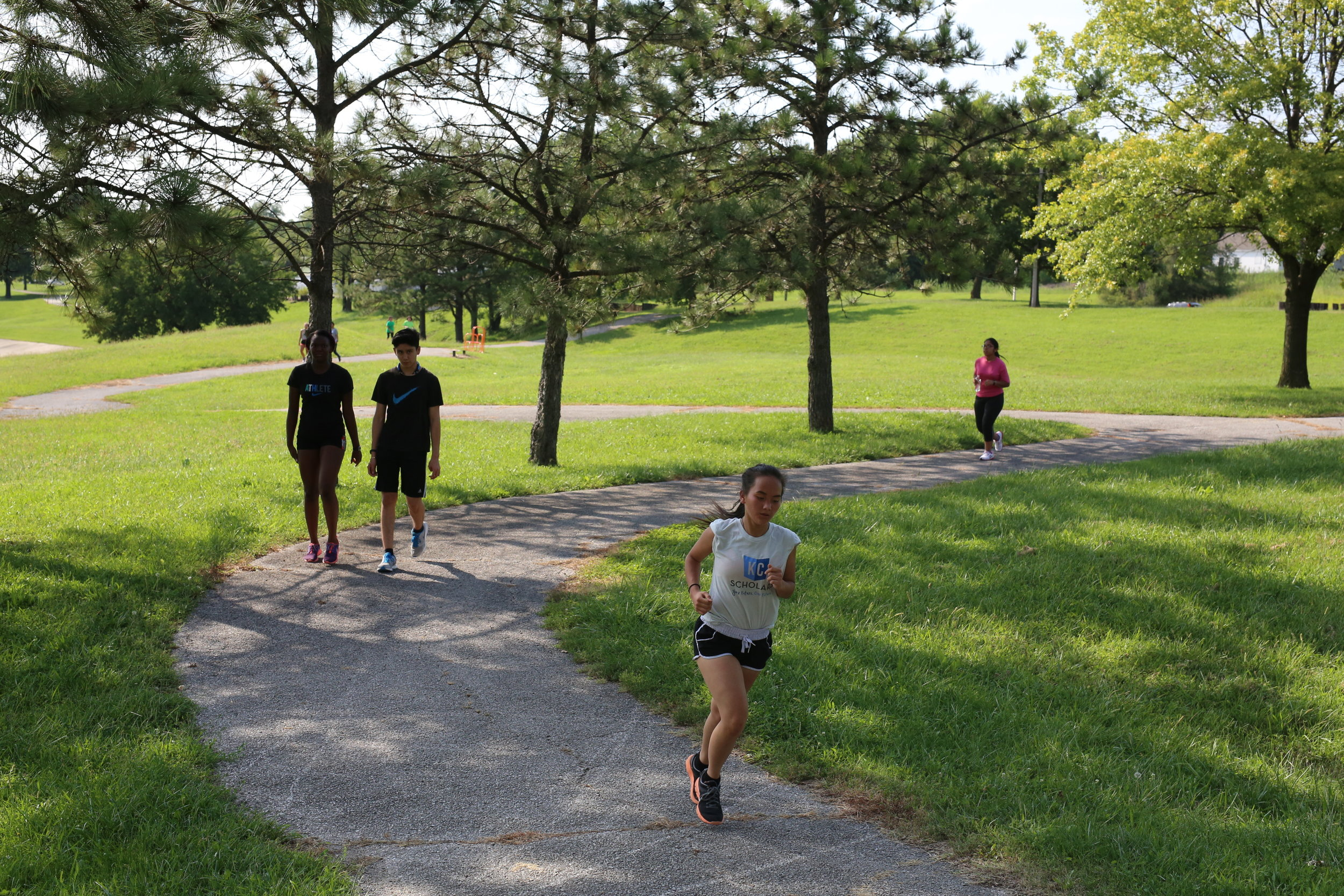 Cross-country runners take the Jersey Creek Trail through Heathwood Park three days a week.