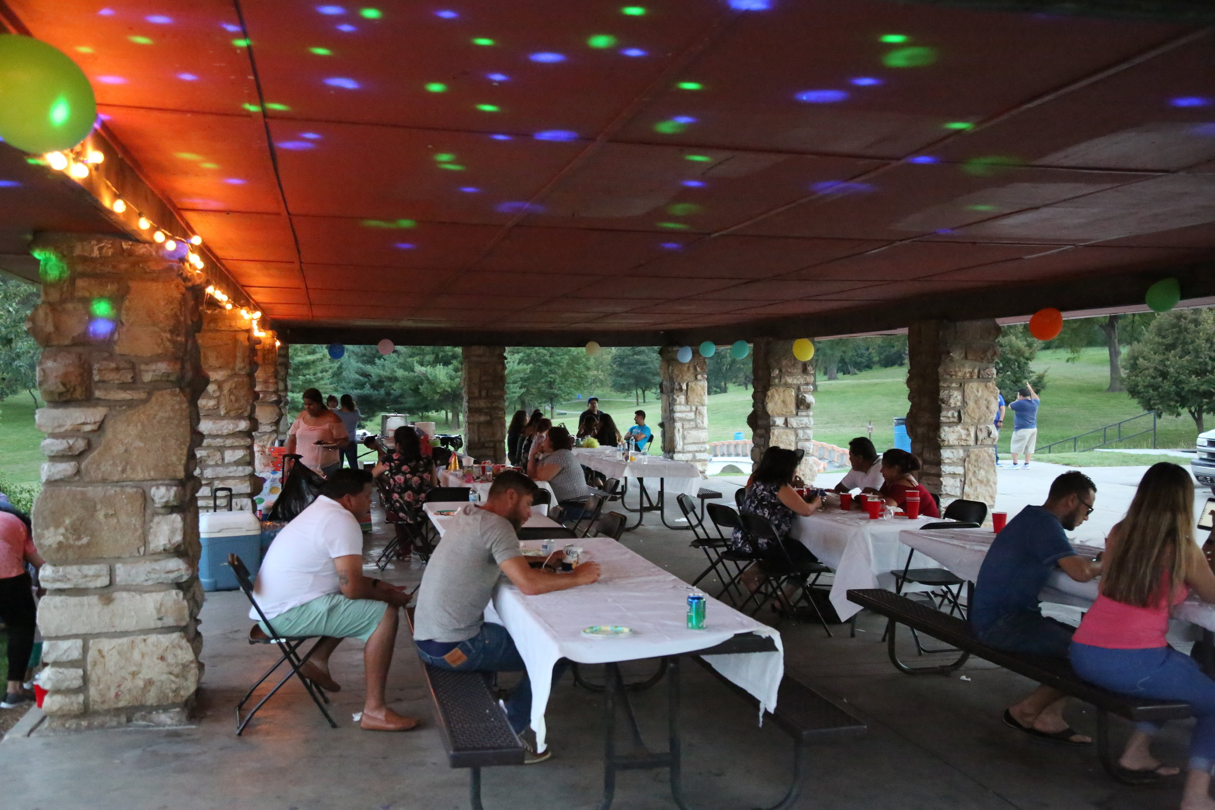 A Saturday night birthday party added tables, lighting, and festivities to the park.
