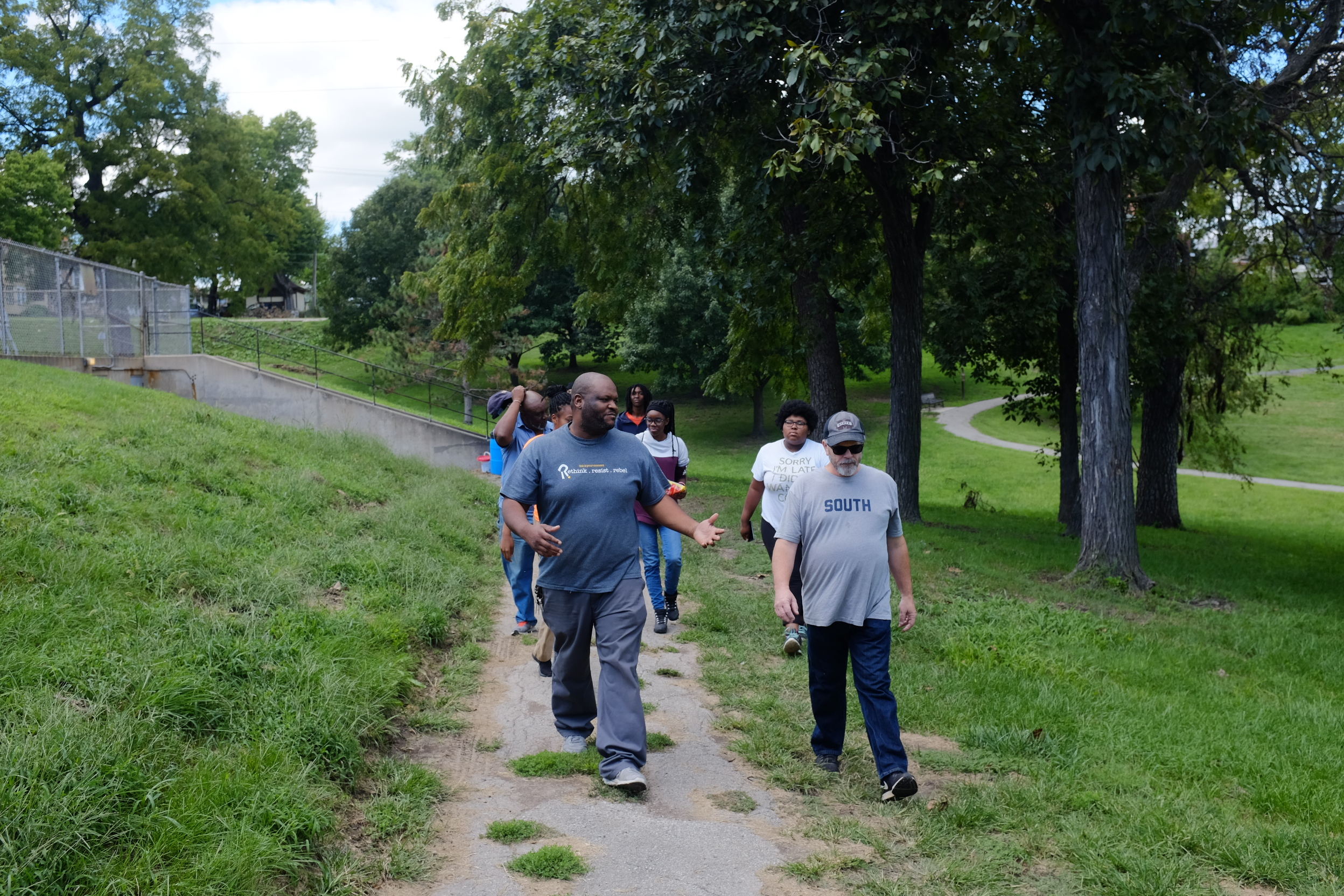 Touring Parkwood with YouthBuild, exploring how to connect a parking lot to a walking trail.