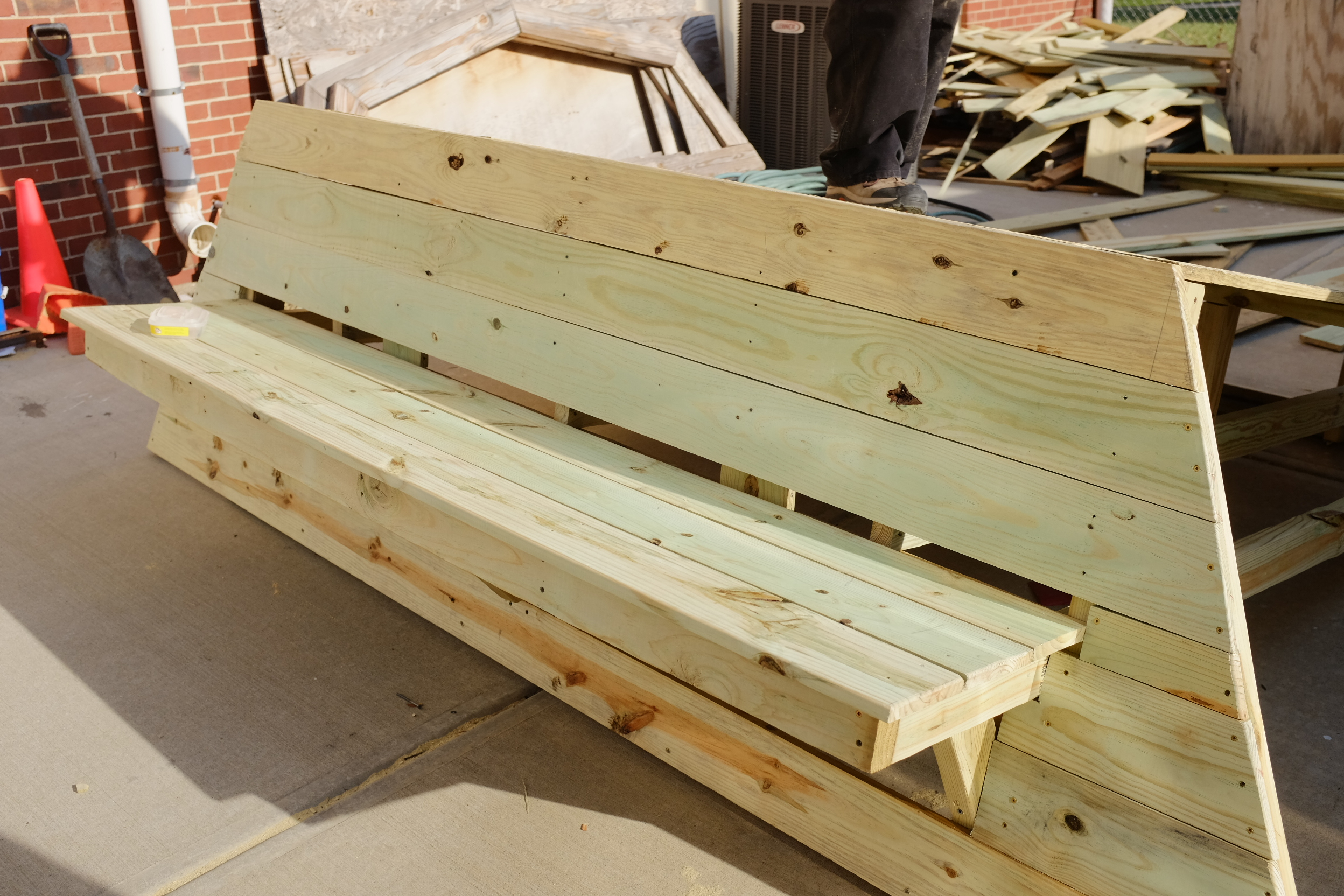 An unfinished Porch/Bench, designed to provide a space to sit and relax.