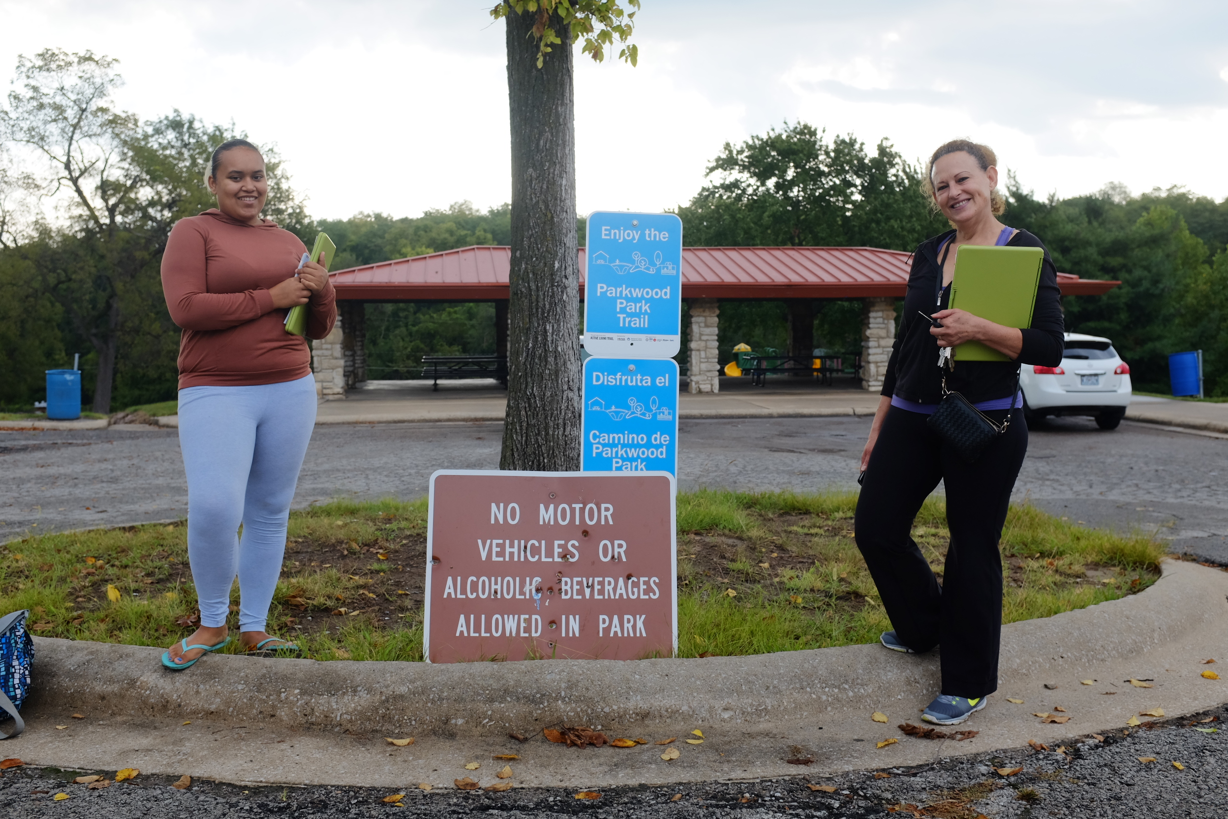 Park observation volunteers Jachai and Maria standing next to a new sign installation.