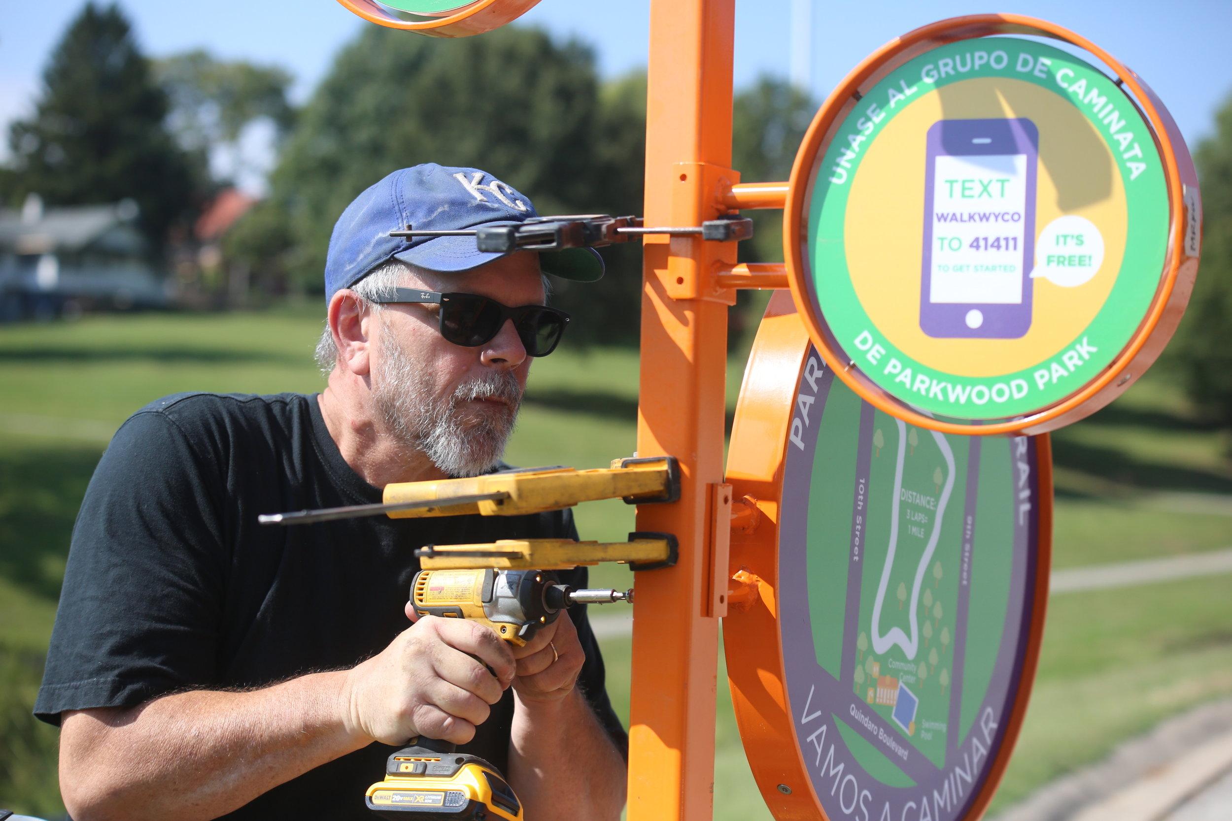 Professor Nils Gore installs the Parkwood Park Totem.