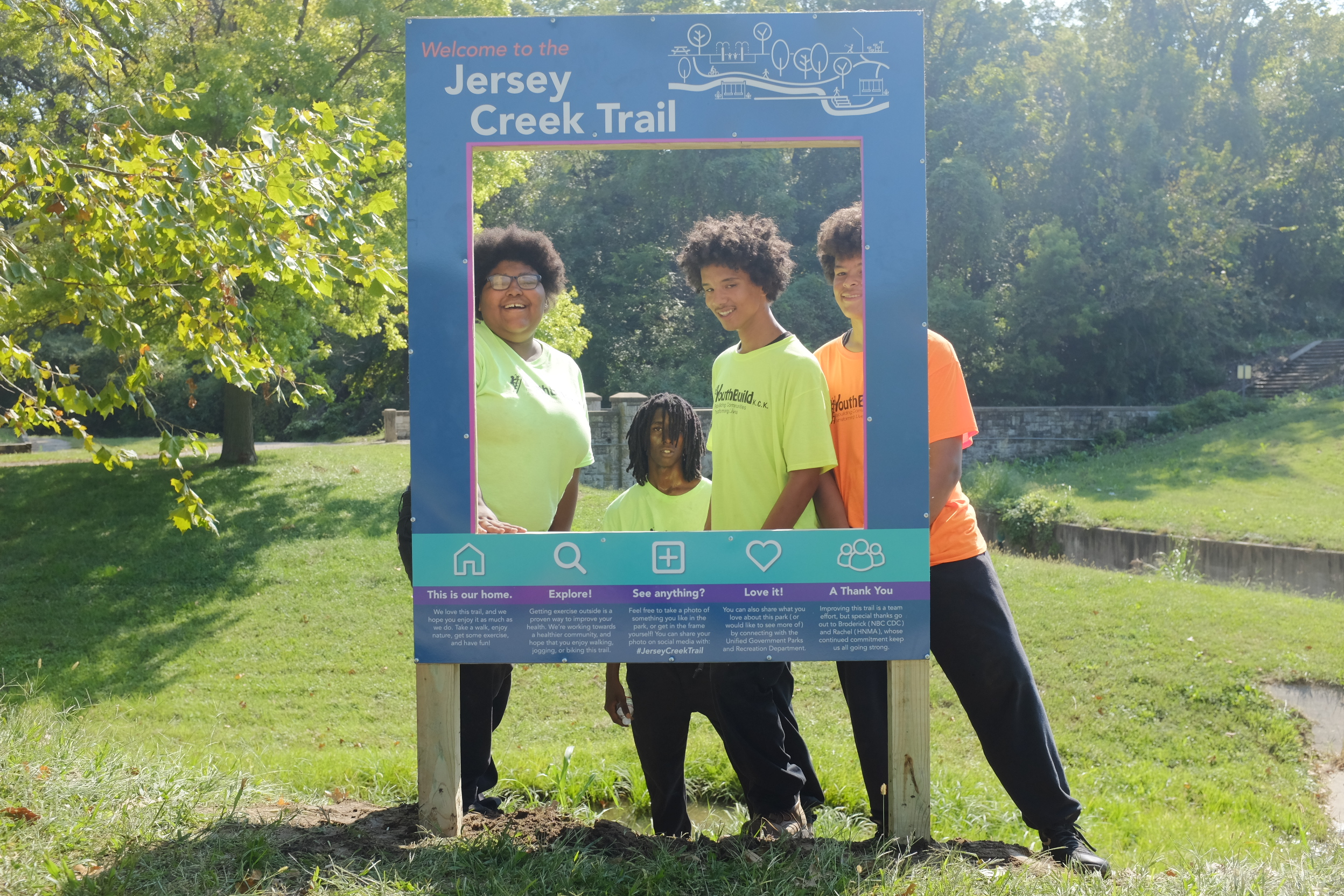 YouthBuilders posing at their newly installed Picture Frame sign, just off the Jersey Creek Trail.