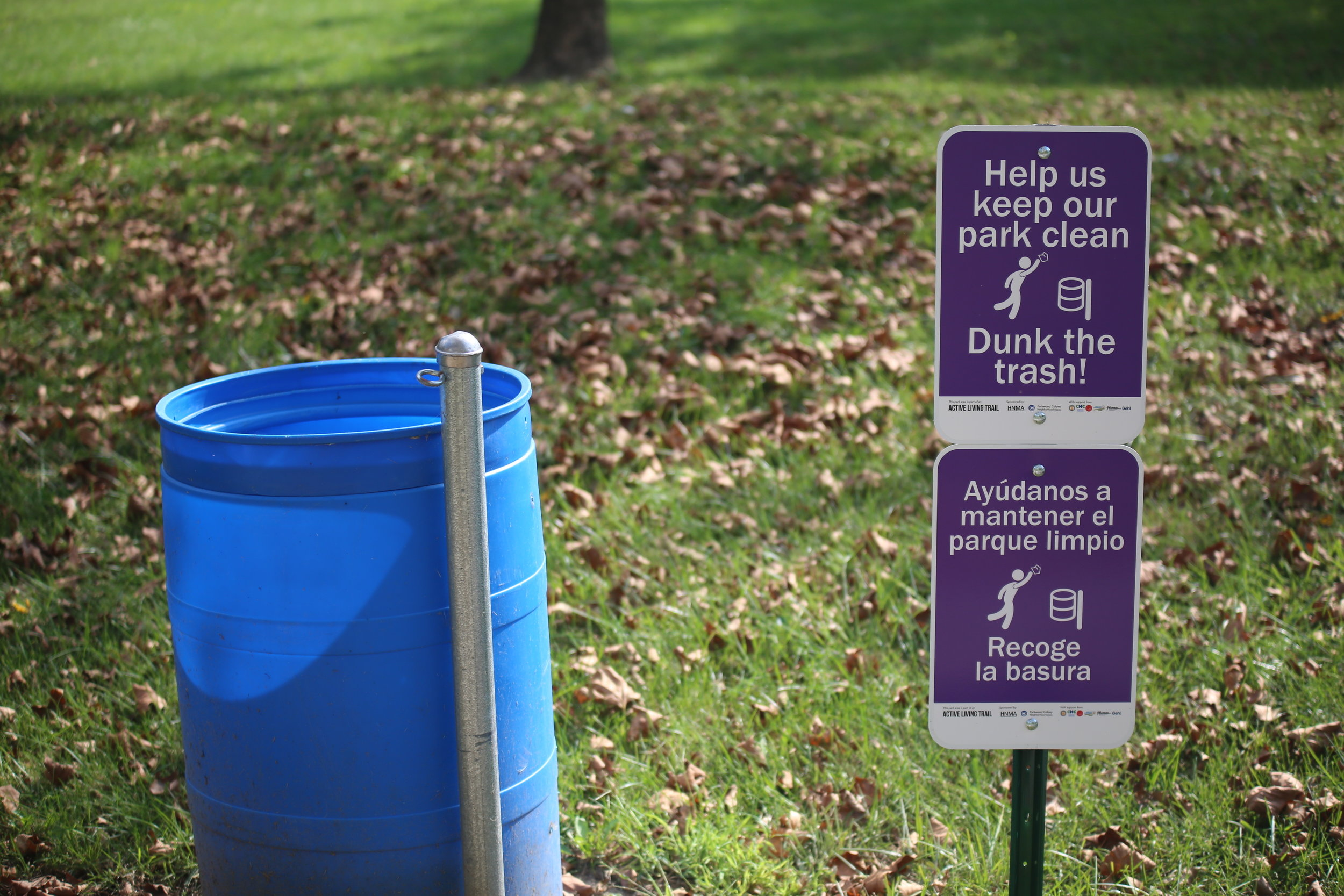 Culturally relevant signs promote the community's role in keeping their park clean.