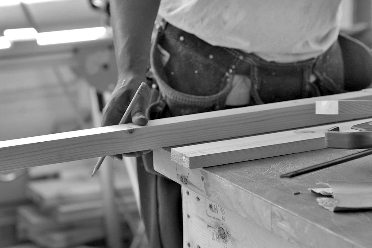 action-hands-wood-bw.jpg