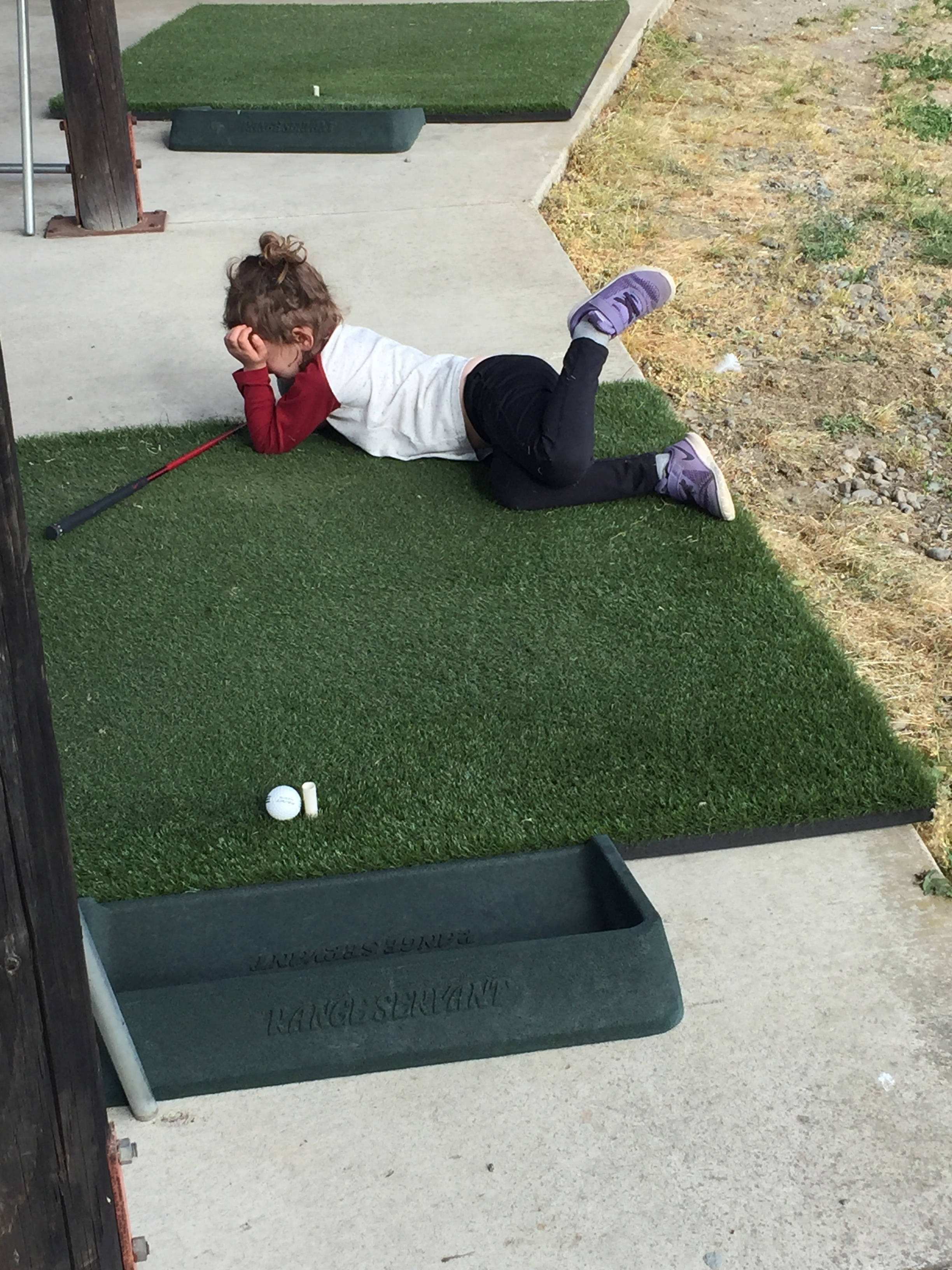 Author Kristie Syke's daughter just not into golf that day.