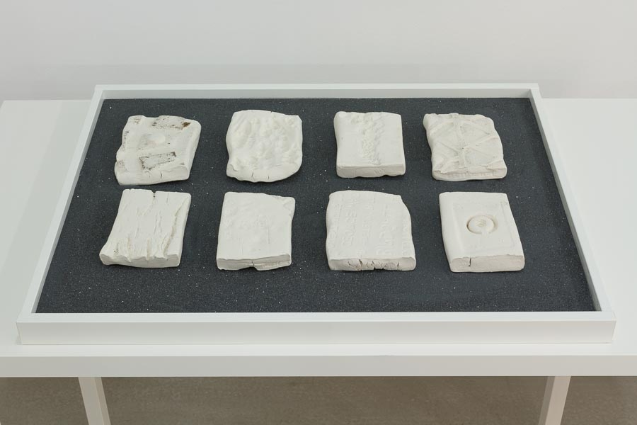 Liene Bosquê     Peekskill - NY, Walk II, October 24,  2015    Paper clay, carborundum grits and public participation    6 x 4 x 1 inches (approx. each piece)    8 pieces
