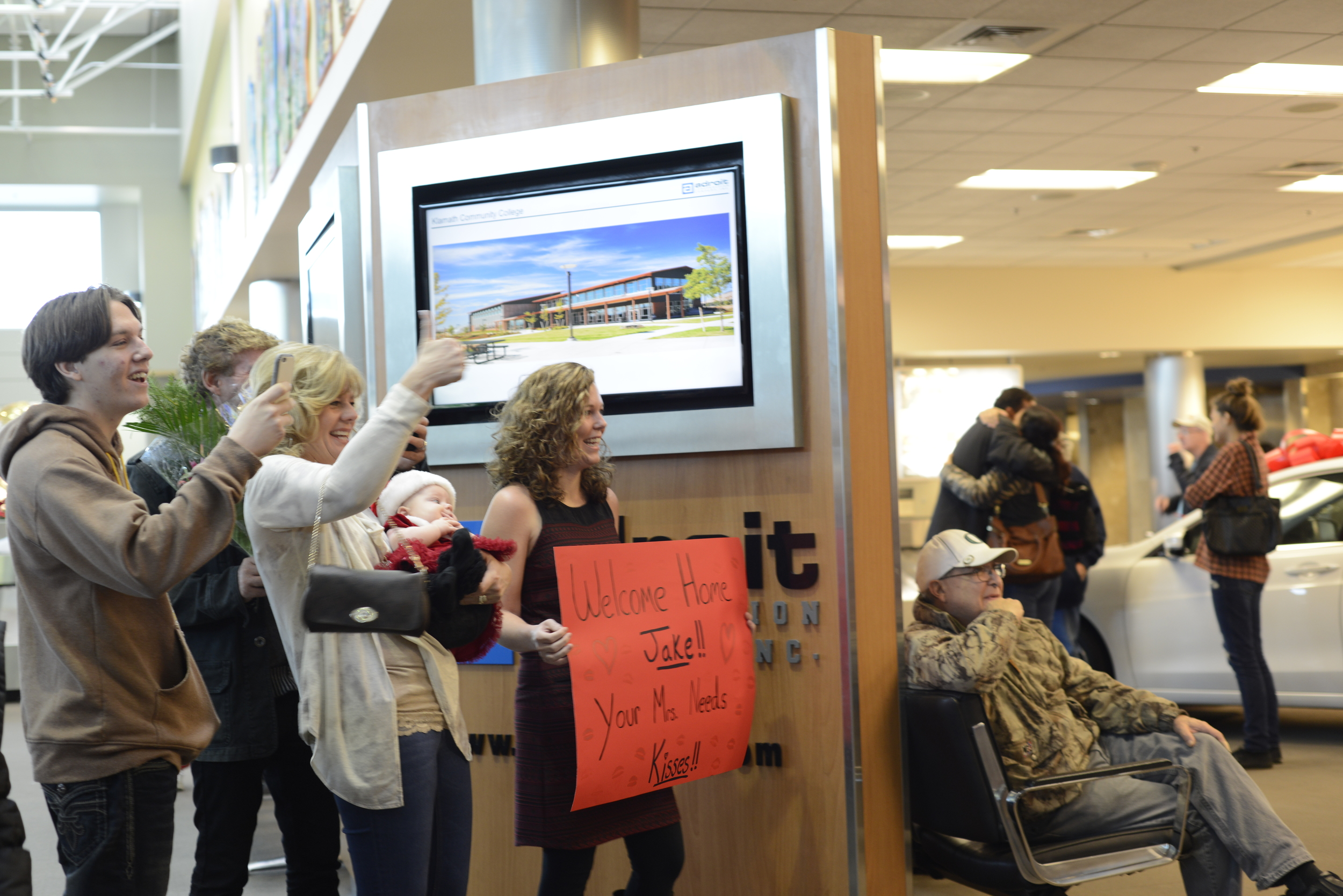 Family and friends greeting Jake.