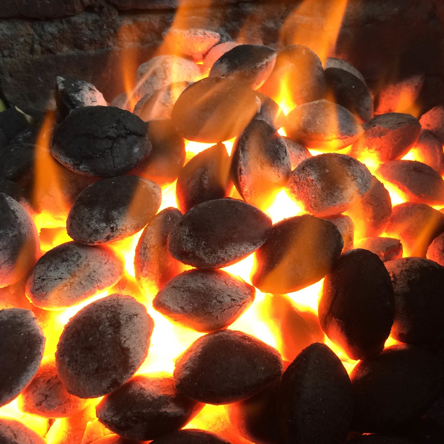 Green charcoal briquettes in BBQ