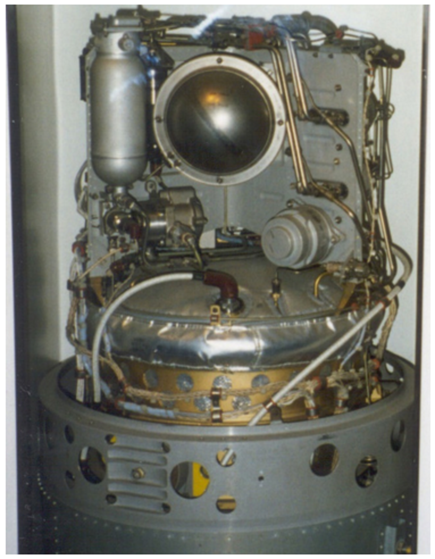 Left: Part of an unflown Apollo fuel cell [National Air and Space Museum]