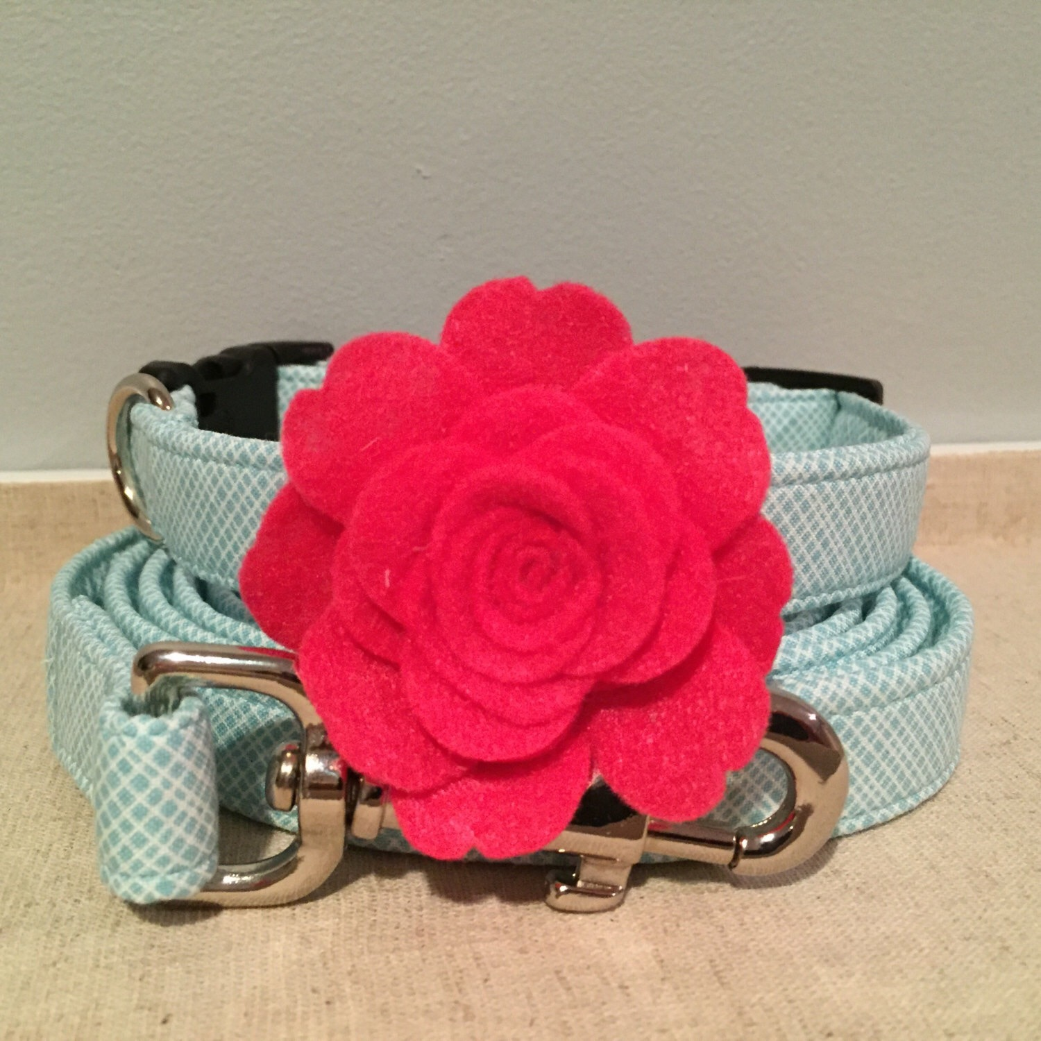 Spoiled Paws Bowtique features handmade detachable flowers and collars.