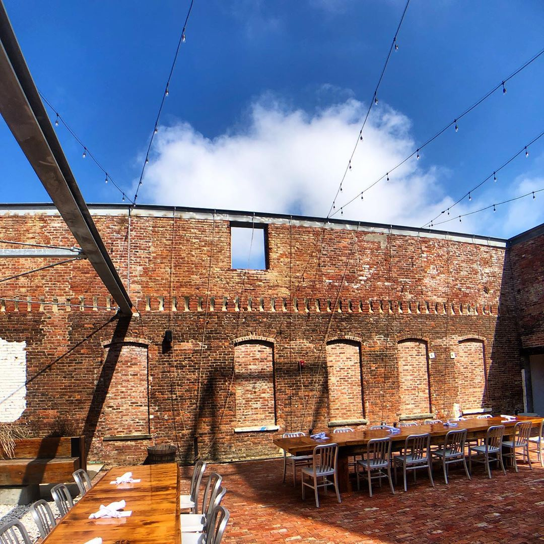 Located at the entrance of WCP, the COURTYARD is an enclosed outdoor brick oasis with a bar and seating and 22-foot-high brick walls. Guests can access the Hall, Brewery, Restaurant and Chapel.