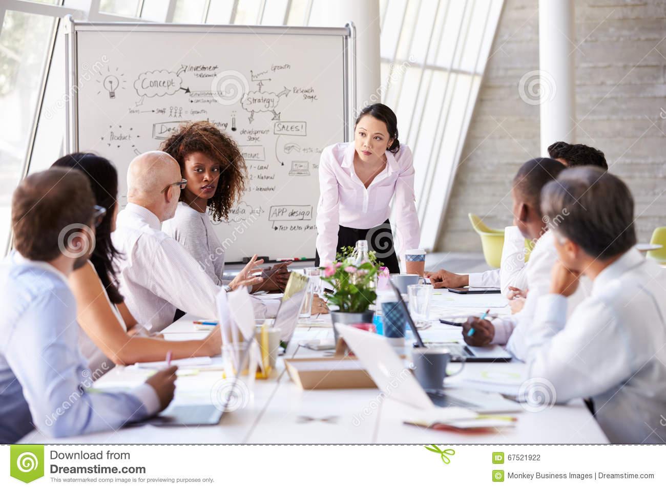 asian-businesswoman-leading-meeting-boardroom-table-67521922.jpg