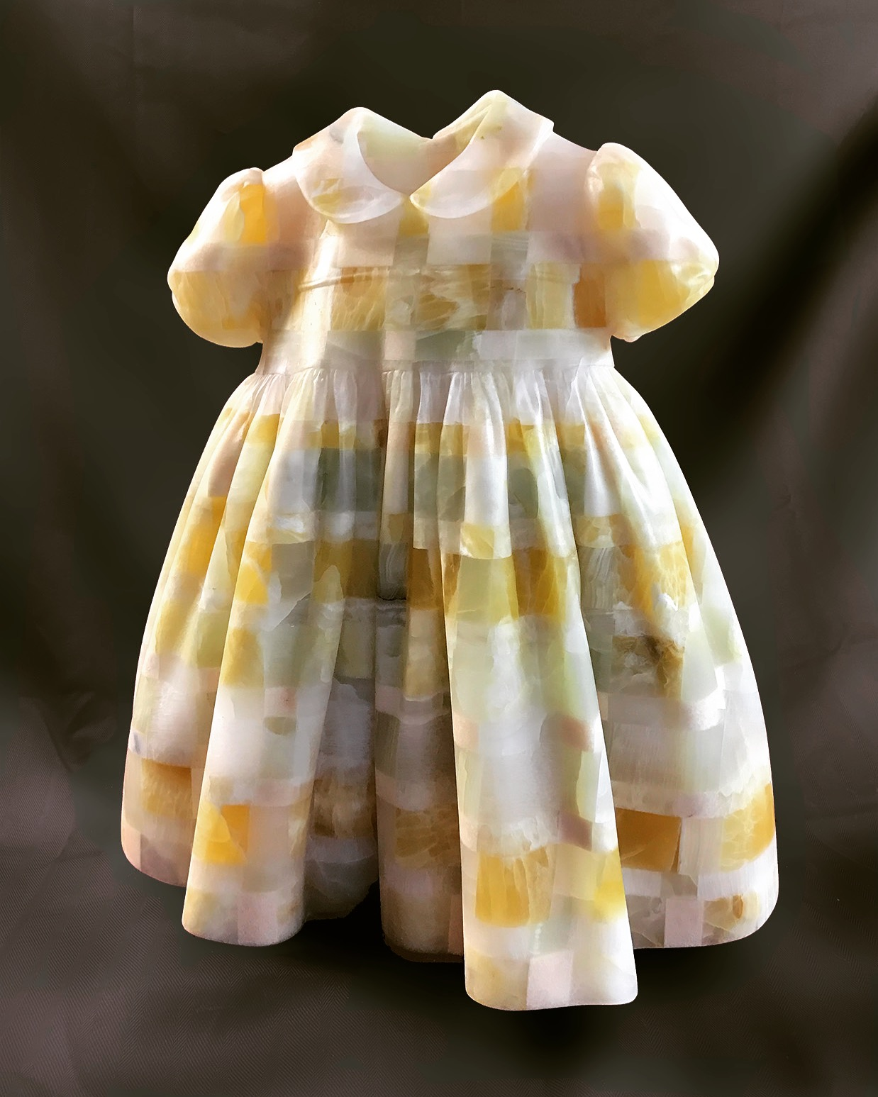 Little Girls' Dresses  In the series,  Little Girl's Dresses , light plays a critical role. By choosing translucent stones and carving delicate layers of lace and fabric, light passes through transforming a simple child's dress into a lush, sensual memory.