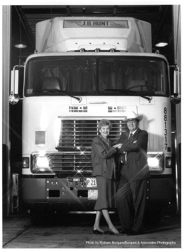 Johnelle and J.B. Hunt stand in front of one of their trucks in 1988.