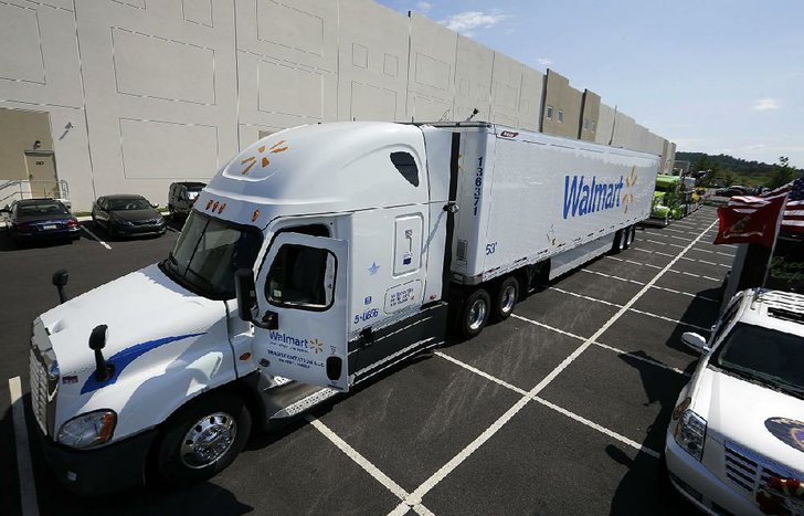 Photo by MEL EVANS / AP  A Wal-Mart truck is parked in front of a distribution center last year in Bethlehem, Pa. Wal-Mart is testing the use of cameras inside some of its commercial vehicles.