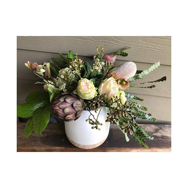 Artichoke, Banksia, Helleborus, Seeded naked weeping eucalyptus, garden roses...big lush sigh from moi on this gorgeous lady 🌿 . . . #eventflowers #artichoke #designer #vegy #rustic #craggycharm #rose #protea #banksia #eventflorist #florist #floristlife #newwest #newwestminster