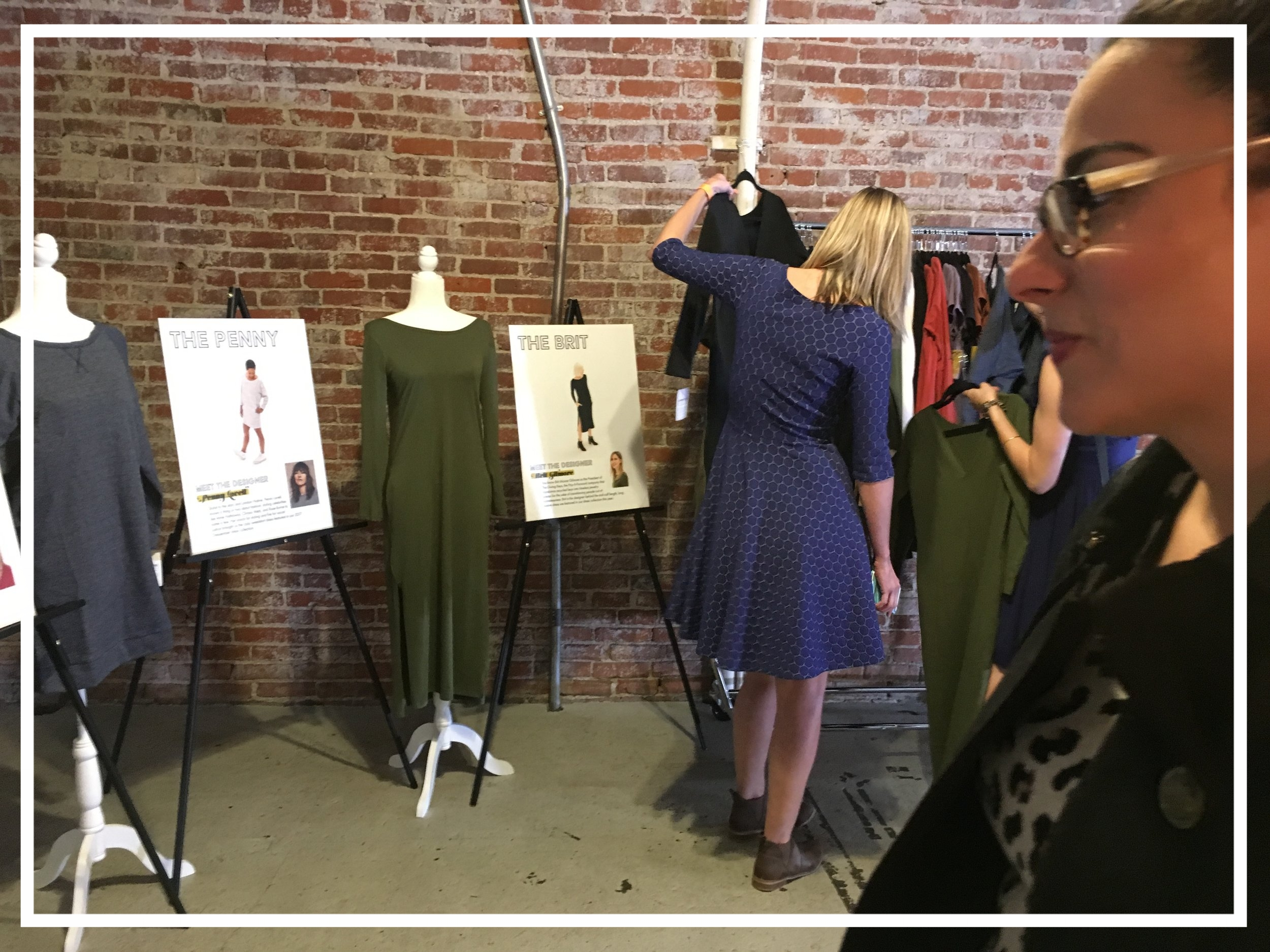 Maria Elena admiring some of the styles from the 2017 Dressember Collection.