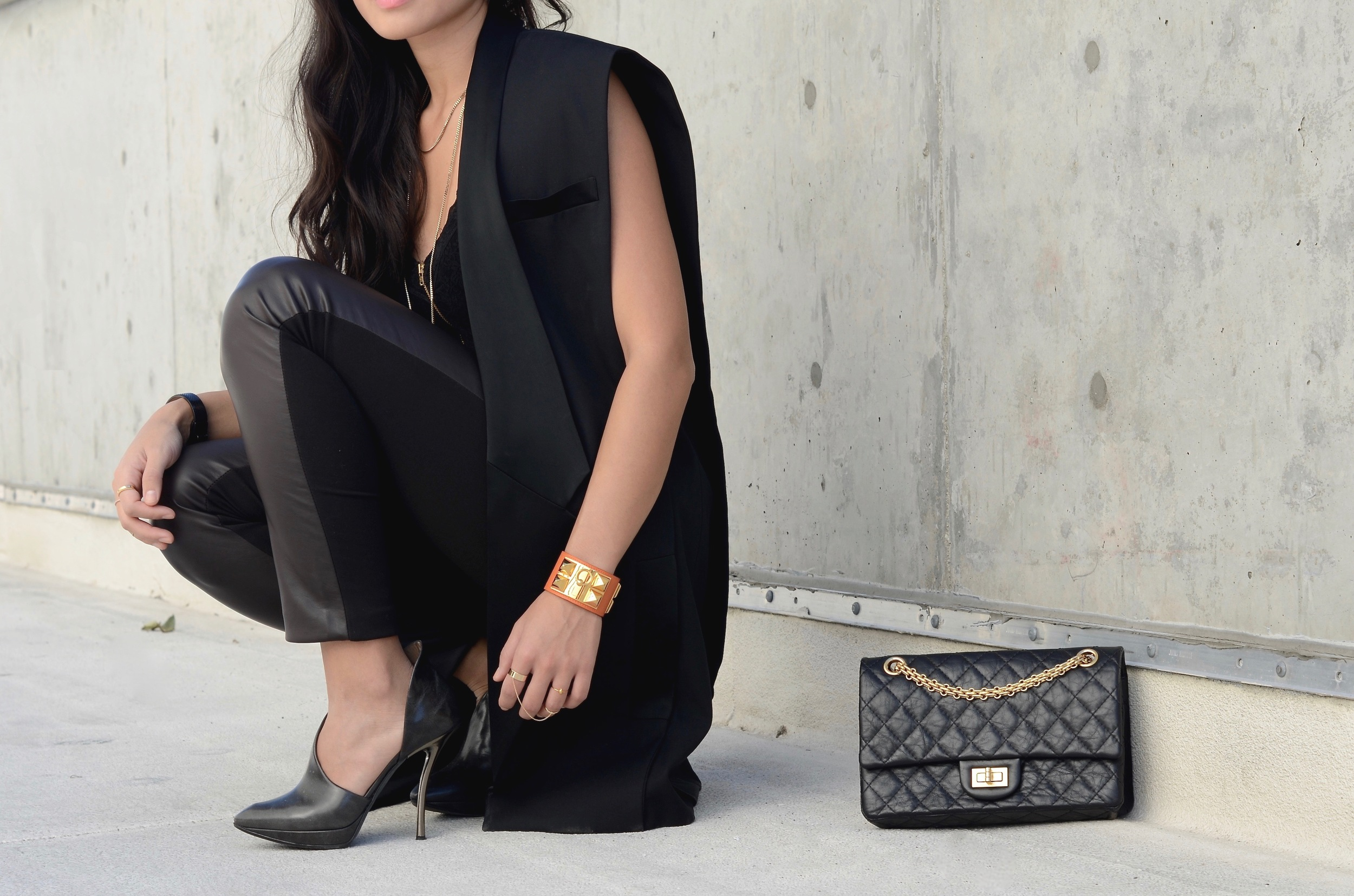 Just Goh With It-Outfit-black-lanvin-cutout-ankle-boots-hm-balmain-sleeveless-blazer-leather-chanel-classic-3.jpg