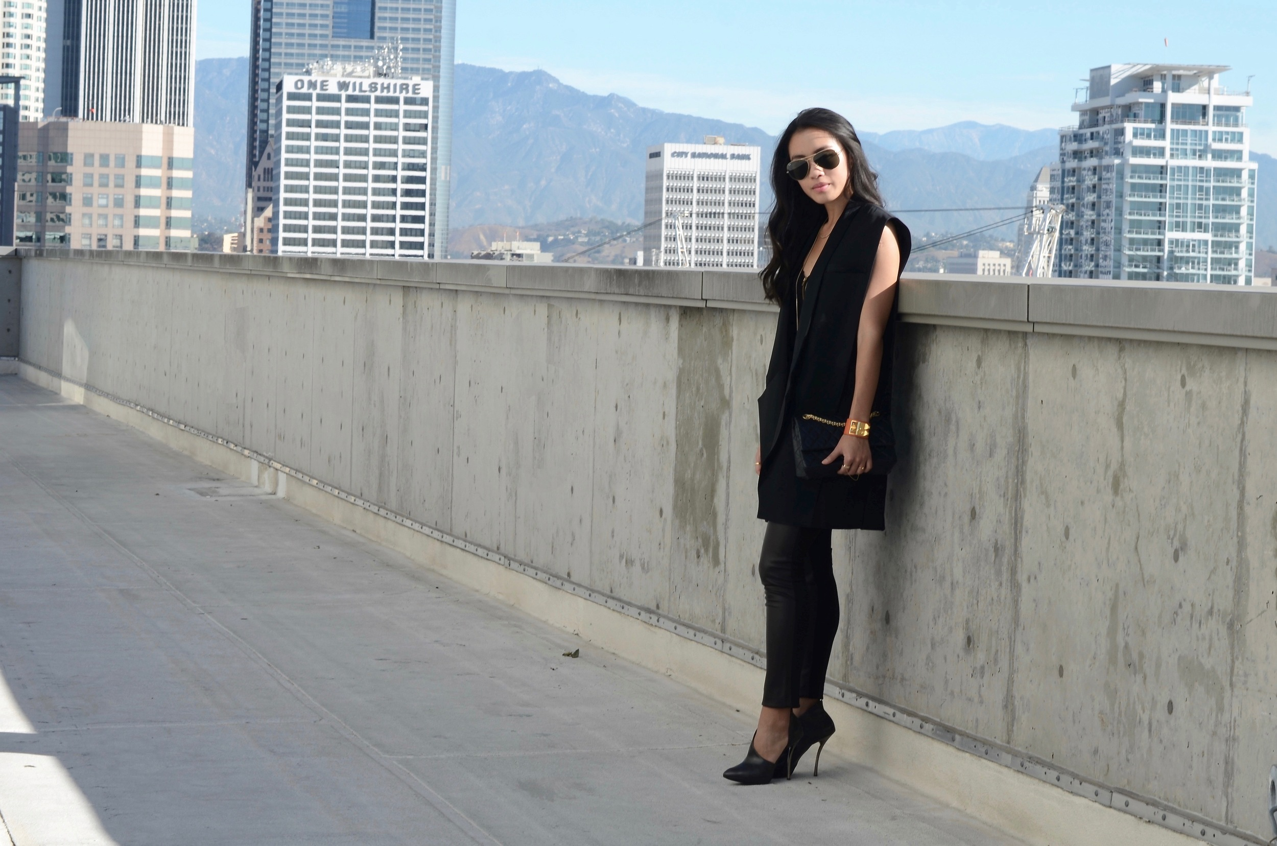Just Goh With It-Outfit-black-lanvin-cutout-ankle-boots-hm-balmain-sleeveless-blazer-leather-chanel-classic-6.jpg