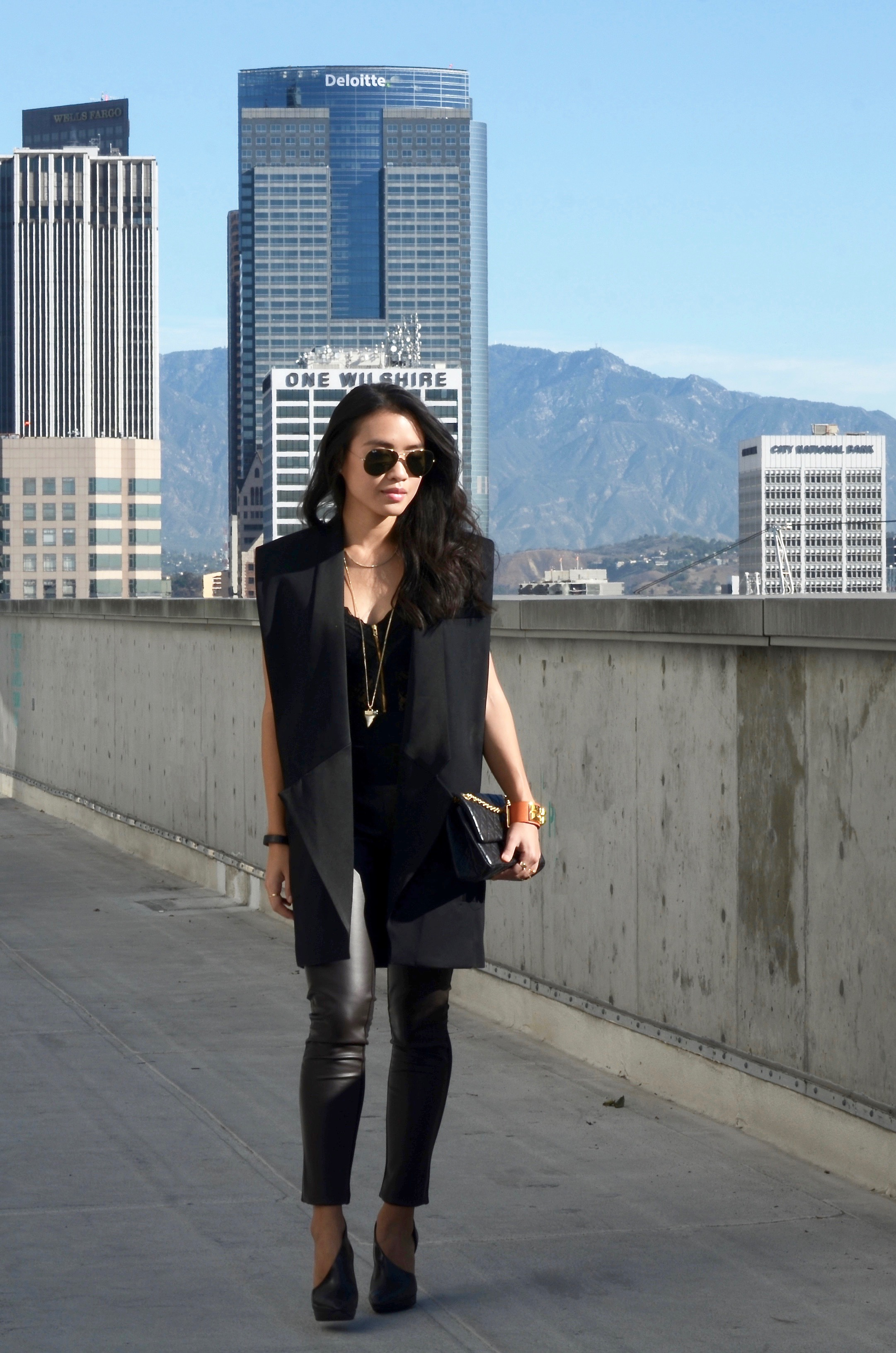 Just Goh With It-Outfit-black-lanvin-cutout-ankle-boots-hm-balmain-sleeveless-blazer-leather-chanel-classic-9.jpg