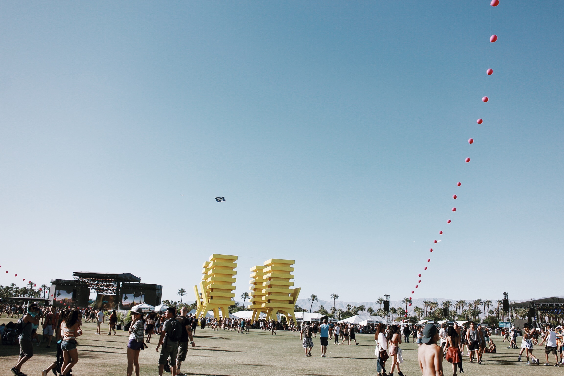 The festival grounds - To the left is the main stage, and the yellow things are art installations.