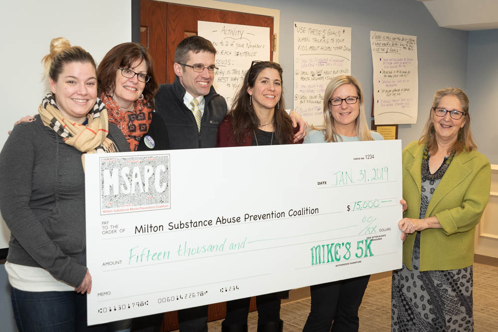 Family and friends of Mike Mulcahy present a welcomed $15,000 donation to MSAPC at the January 31, 2019 meeting