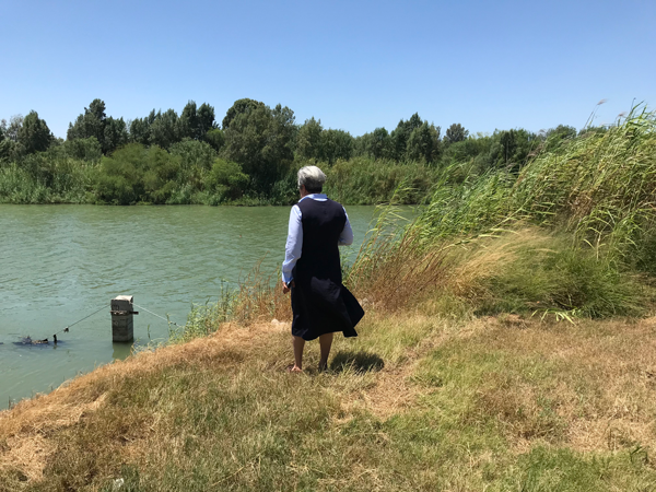 Sr. Norma surveys the Rio Grande with Mexico on the far side.