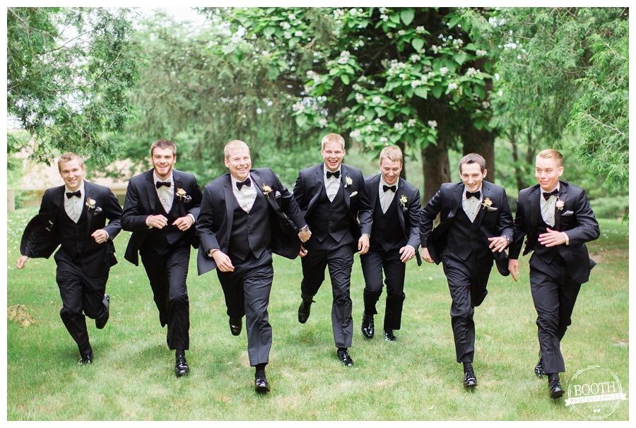 groomsmen running at a University of Madison wedding