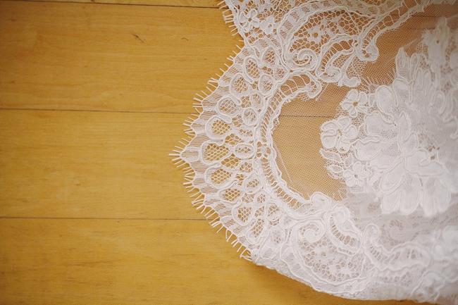 lace edge a bride's wedding dress