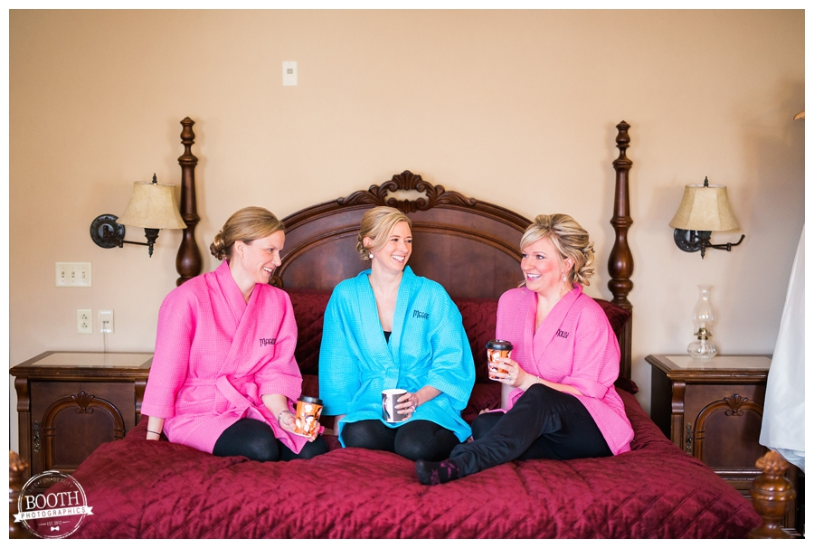 bridesmaids getting ready for a wedding on a four poster bed at Hotel Ruby Marie