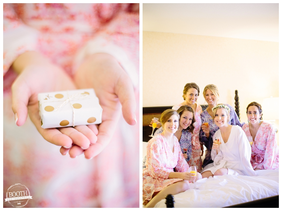 bride giving her bridesmaids a gift while wearing plum pretty sugar robes