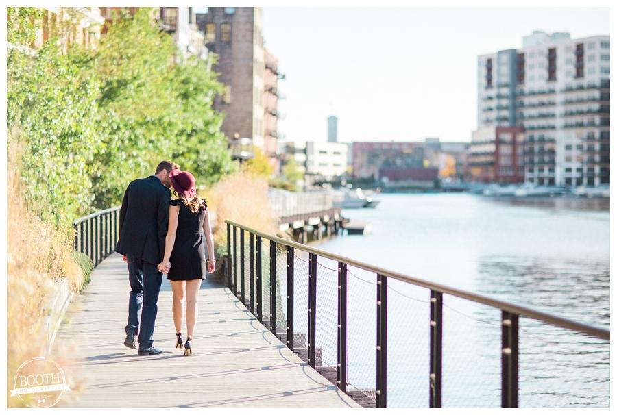 couple kissing along the lake walk of Milwaukee's Historic Third Ward