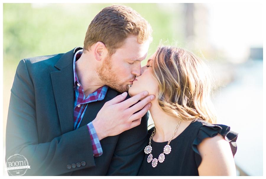 couple kissing along the lakewalk of Milwaukee's Historic Third Ward